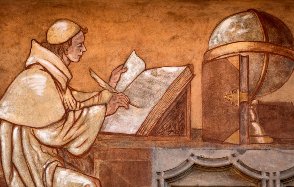 Medieval scribe copying the scriptures